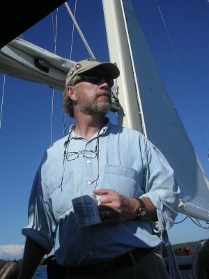 Tom Kelly aboard his sailboat, Cygnet