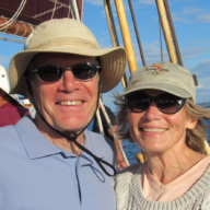 Couple smiling while sailing on ship