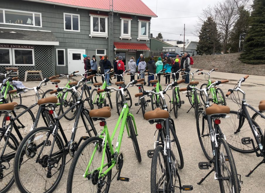 Bicycles in forefront with a class in background getting ready for a cycle program