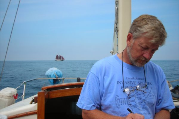 Founder with schooner in background