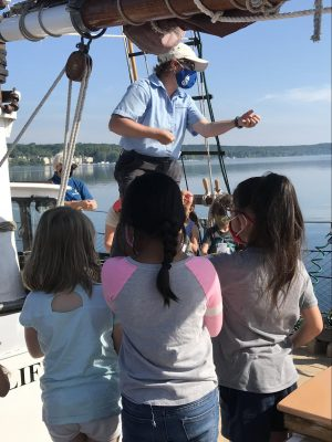 crew member talking to students