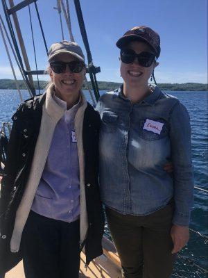 Mother and daughter smiling on schooner