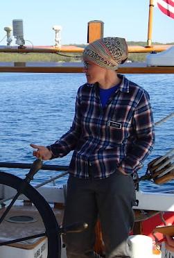 female captain at schooner wheel