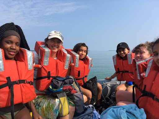girls with orange lifejackets on dingy