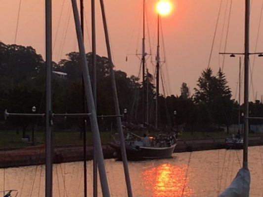 schooner at dock at sunset