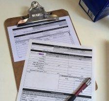 data sheets on clipboard